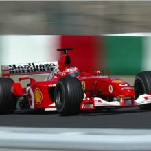 A red race car on a track branded with Marlboro and Shell logos.