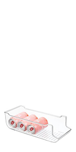 Clear Plastic Fridge Bin Soda Pop Can Holder with Stacked Bubly Sparkling Water on White Background