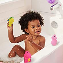 Little boy playing squeeze squirt toys in the shower