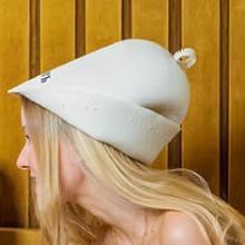 women in a hat sauna