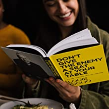 girl smiling reading dont give the enemy a seat at your table