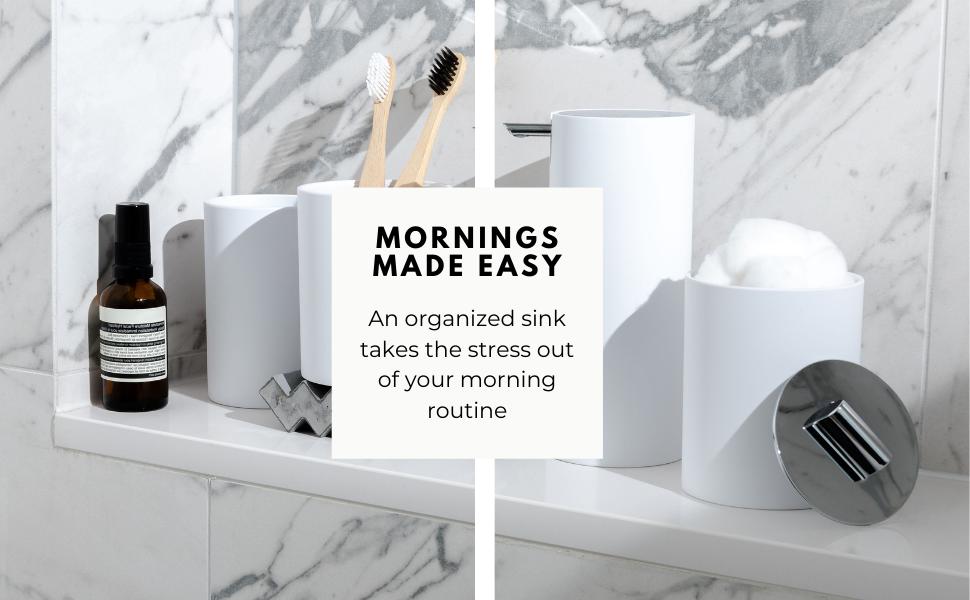 Modern bathroom accessories set, sleek matte black soap dispenser, matte black toothbrush holder