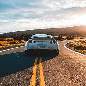Car driving down long road