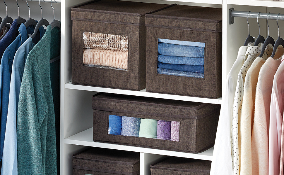 brown fabric storage totes with view window, lid on white shelves, tops on hangers in closet setting