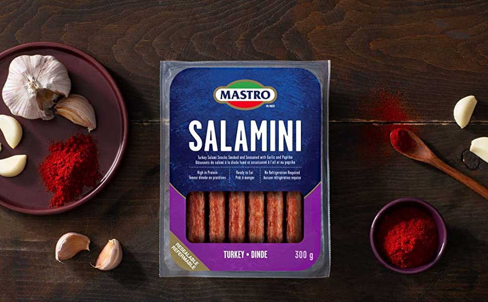 Package of Mastro Salamini Turkey on a table with garlic and spices