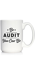 Text says Be Audit You Can Be in bold font, printed onto a white coffee mug