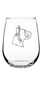 Design of a boxer face in profile with pointed ears, engraved onto a stemless wine glass.