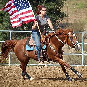 Girl riding an American flag