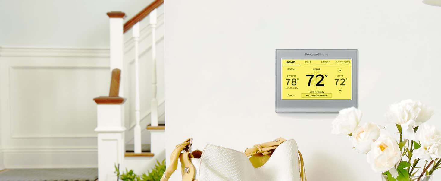 WiFi Smart Color Thermostat with yellow screen on wall