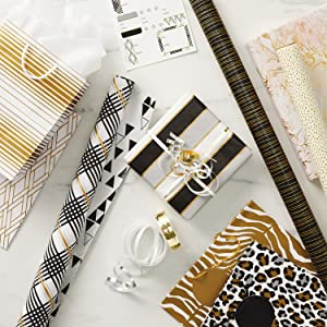 Elegant wrapping paper in black, white and gold, animal print gift bags