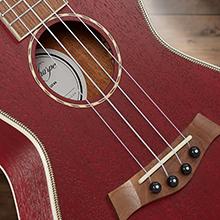 dark red ukulele front, satin finish, rosette detail, walnut bridge, four Aquila string, ABS binding