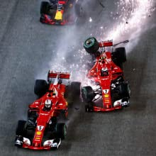 Two race cars skidding into each other.