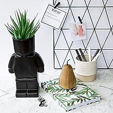 black block person head pot planter