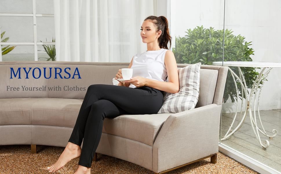 women sit on sofa for lounge, wear black womens yoga dress pants