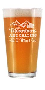 """Text says The mountains are calling and I must go,"""" with hand engraved image of mountains."""