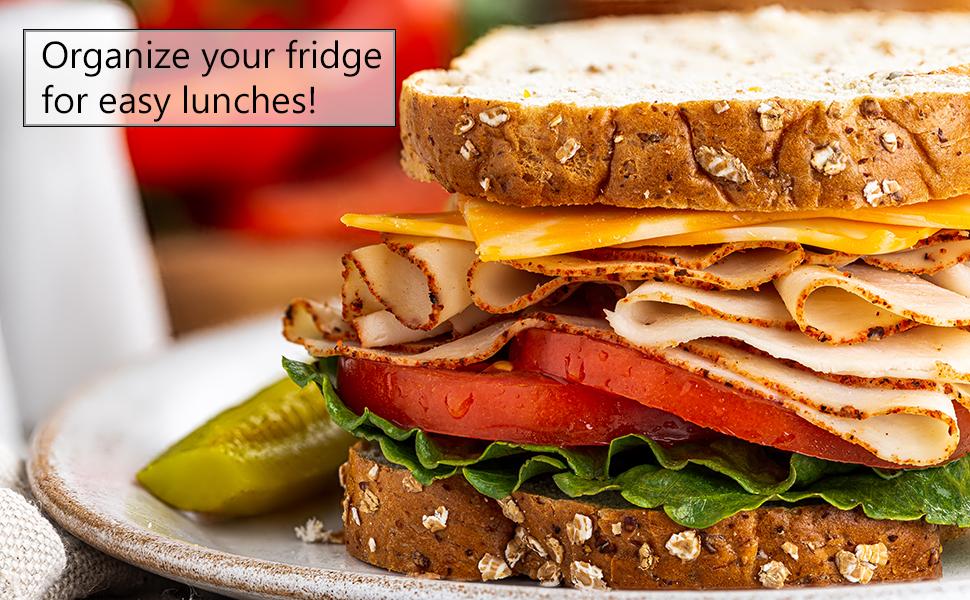 Sandwich with multi-grain bread, cheese, turkey, tomato, lettuce and pickle