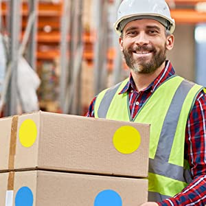 man holding boxes with dots on them