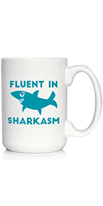 Text says Fluent in Sharkasm, with design of a sassy looking shark. Printed in teal/light blue  ink