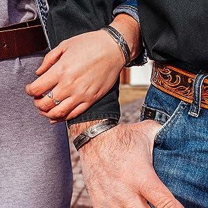 Man and woman modelling bracelets