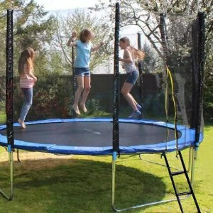 Kids jump on trampoline