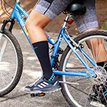 Image of a woman on a bike wearing compression socks.