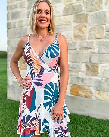 summer floral dress has a deep v neck and adjustable shoulder straps