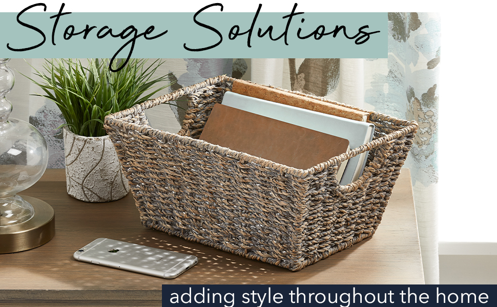 Storage Solutions Header, wood table, cell phone, plant, books in basket, curtains in background