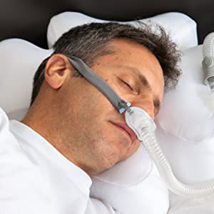 Man sleeping with grey P10 headgear.