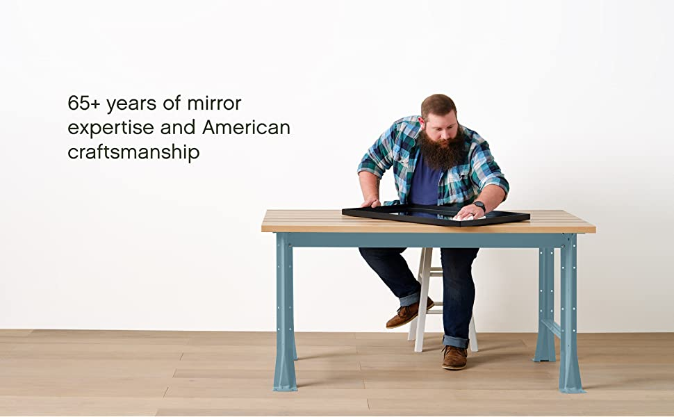 Guy Cleaning Mirror - 65+ years of mirror expertise and American craftsmanship