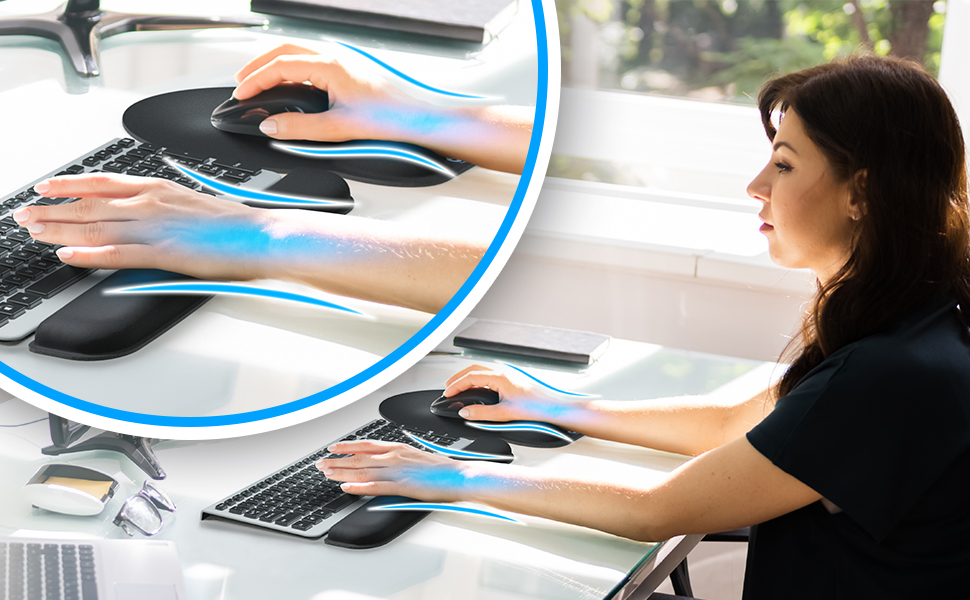 Woman in office using the keyboard and mouse wrist rest with lines showing how it supports hands