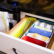 Set of 3 bins bright in a kitchen drawer with a whisk and towels