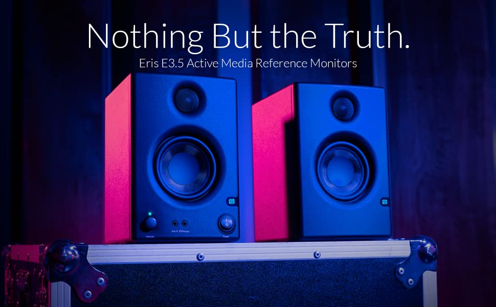 PreSonus Eris E3.5 3.5-inch Studio Monitors on road case in pink and blue RGB lighting