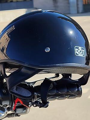 Sniper motorcycle half helmet on handle of a cruiser motorcycle