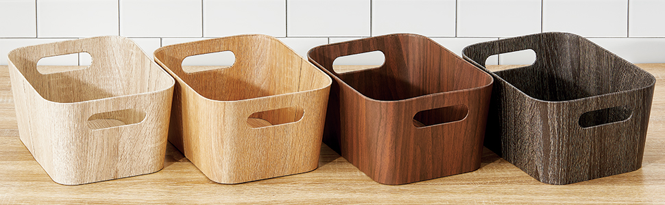 Empty Wood Grain Paperboard Bins with Handles in Four Different Brown Colors on Kitchen Countertop