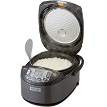 rice cooker with lid opened with freshly steamed white rice inside