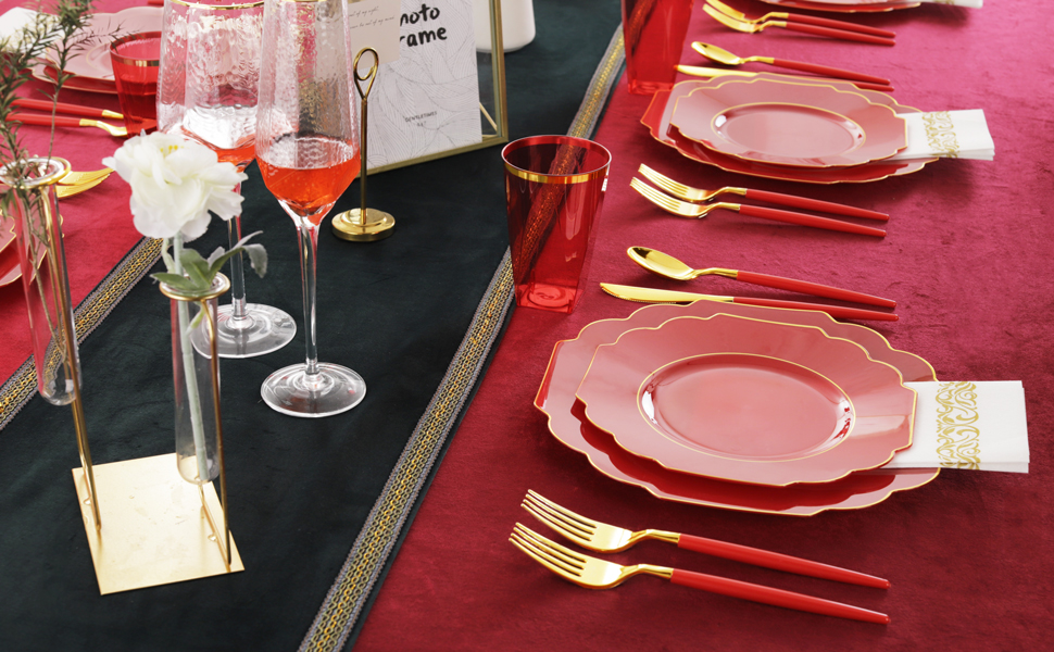 Red plastic plates and gold silverware with red handles on the dining table