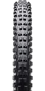 Top view minion tire. Big treads on outside edge of tire, set of two smaller inside tread.