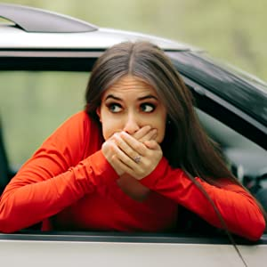 woman experiencing car sickness and nearly vomiting