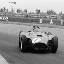 A race car going around a sharp turn.