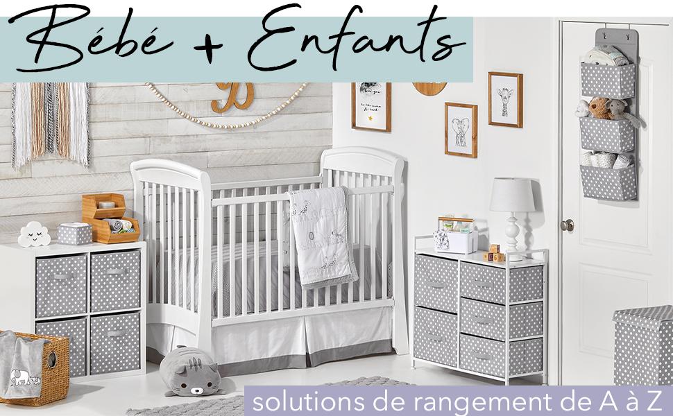 Bébé + Enfants, commodes blanches, tiroirs en tissu gris à pois blancs, berceau