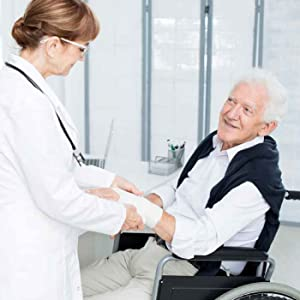 A doctor providing first aid to an elderly man
