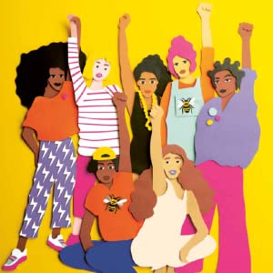 A group of people with an empowerment arm raised.