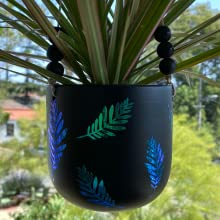 holographic vinyl leaves on a planter decoration using kassa adhesive color changing crafting paper