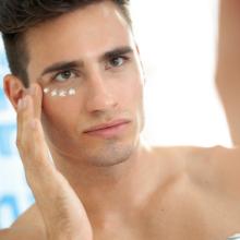 Man applying cream.