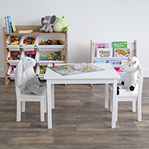 Kids playroom with table and 2 chairs set, toy storage organizer with 9 bins, and bookrack