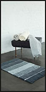 Black grey charcoal bath mat with matching towels and accessories