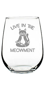 Text says Live in the Meowment, with design of a cat sitting cross legged, meditating