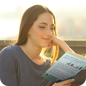 Woman smiles while reading Bible.