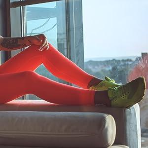 A women wearing leggings behind the window