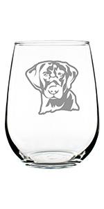 Design of a Labrador face engraved onto a stemless wine glass.